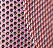 Metal background with holes. Royalty Free Stock Image
