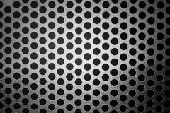 Metal background with holes Stock Image