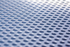Metal background with holes Royalty Free Stock Images