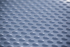Metal background with holes Stock Images