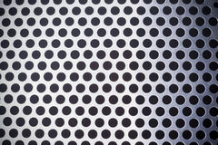 Metal background with holes Royalty Free Stock Photography