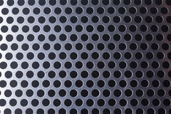 Metal background with holes Royalty Free Stock Photos