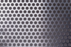 Metal background with holes Stock Photography