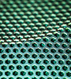 Metal background with holes. Royalty Free Stock Photography