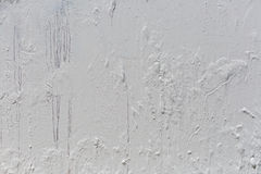 Metal background painted with white paint. Royalty Free Stock Photography