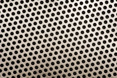 Metal Background Pattern. Hole Punched Pattern Metal Background stock image