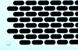 Metal background with perforated holes Stock Images