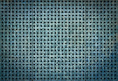 Metal background with perforation of square holes. Blue steel texture. Bluish metallic background with perforation of square holes Royalty Free Stock Photo