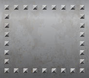 Metal background with rivets Stock Images