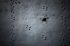 Metal Background with Rivets and Holes Royalty Free Stock Photography