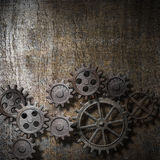 Metal background with rusty gears. And cogs Royalty Free Stock Photography