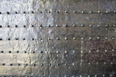 Metal background of  silvered surface with rivets Royalty Free Stock Photo