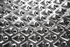 Metal background with small holes stock photo