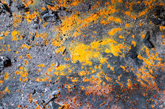 Metal background with spots of rust. texture. Metal background with spots of rust and pieces of charcoal. texture stock photo