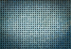 Metal background with square holes. Blue steel texture. Royalty Free Stock Image