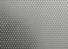 Metal Background. Steel surface with hole pattern Royalty Free Stock Images