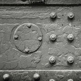 Metal background texture with bolts and rivets Royalty Free Stock Photos