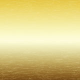 Metal background, texture of brushed gold plate Royalty Free Stock Image