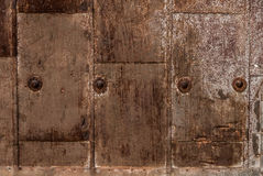 Metal background texture. With rivets looking weathered, worn and scratched Royalty Free Stock Photo