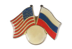 Metal badge. With the American and Russian flags royalty free stock image