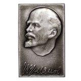 Metal badge. DZERZHINSK, RUSSIA - JUNE 10, 2013: Metal badge. Portrait of Vladimir Lenin, the leader of the 1917 revolution stock image