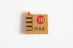 Metal badge in honor of the thirtieth anniversary of the victory. Gilt metal badge in honor of the thirtieth anniversary of the victory with the inscription `30 stock photo