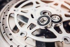 Metal ball bearing on motorcycle disk brake. Stock Image