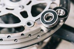 Metal ball bearing on motorcycle disk brake. Royalty Free Stock Image