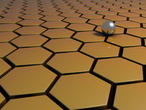 A metal ball on a honey comb pattern Stock Images