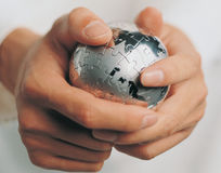 A metal ball in a man's hands royalty free stock photo