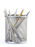 Metal ball-point pens in a support. On white background stock photography