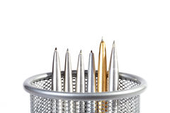 Metal ball-point pens in a support. On white background royalty free stock image