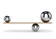 Metal balls balanced on plank Stock Image