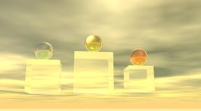Metal balls on a podium. Gold, silver and bronze metal balls on a yellow transparent podium in cloudy background Stock Images