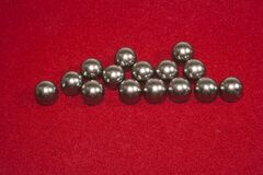 Metal balls on a red background
