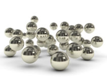 Metal balls on white background. Many metal balls falling on white background Stock Photos
