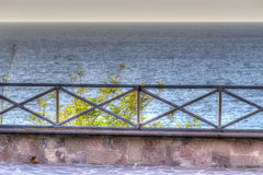 Metal balustrade by the shore Royalty Free Stock Photo