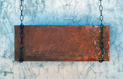 Metal banner. Hanging in a dark grungy room Royalty Free Stock Images