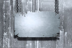 Metal banner. A metal banner held with chains on a grungy background - room for copy on the banner Royalty Free Stock Photography
