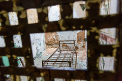 Metal bar door and cell in a prison Stock Image