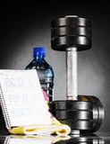 Metal barbell with week program. And water Stock Photo
