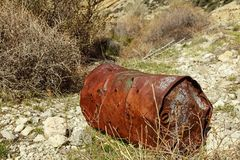 Metal barrel bullet holes trash stock image