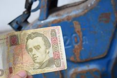 Metal barrel and Ukrainian money, the concept of the cost of gasoline, diesel, gas. Refilling the car. Banknote 100 hryvnia stock images