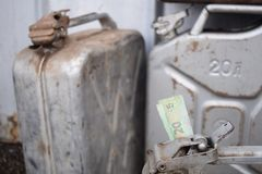 Metal barrel and Ukrainian money, the concept of the cost of gasoline, diesel, gas. Refilling the car. 20 liter and banknote 20 stock image