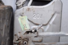Metal barrel and Ukrainian money, the concept of the cost of gasoline, diesel, gas. Refilling the car. 20 liter and banknote 20 royalty free stock photography