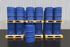 Metal barrels of fuel on a pallet are in the industrial warehous Stock Images