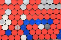 Metal barrels wall Stock Images