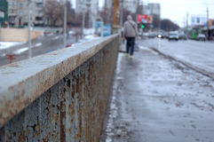 Metal barriers bridge. Metal barriers of the bridge and the people passing by Stock Photos