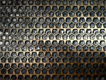 Metal bars on a gray background. Stock Images