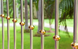 Metal bars on a green background Royalty Free Stock Images